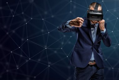 Fighter in a suit with virtual reality glasses