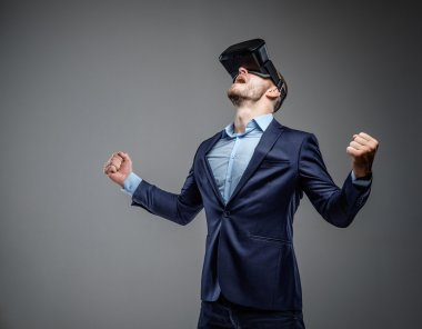Male in a suit with virtual reality glasses