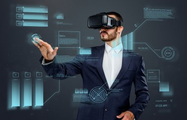 Male in a suit with virtual reality glasses on his head working in virtual financial world stock vector