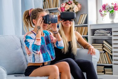 Girls with virtual reality glasses