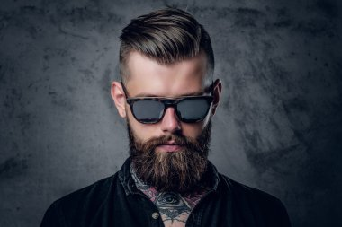 Tattooed hipster male in sunglasses