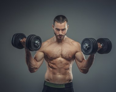 Male doing biceps workouts with dumbbells