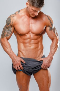 muscular man bodybuilder poses