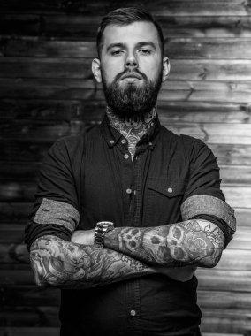 Serious tattooed male