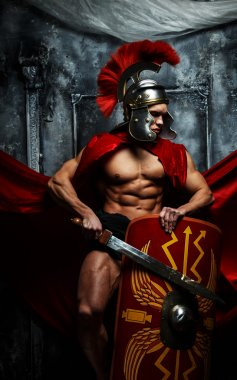 Muscular warrior holds shield and sword
