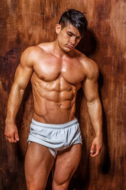 Awesome young muscular male possing