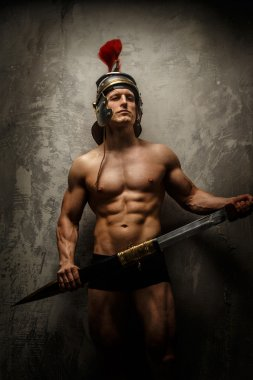 Muscular male warrior posing showing his body