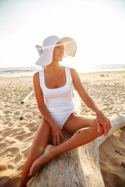 Middle age woman on a beach.