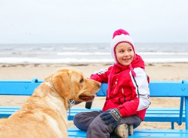 Little girl possing with a dog