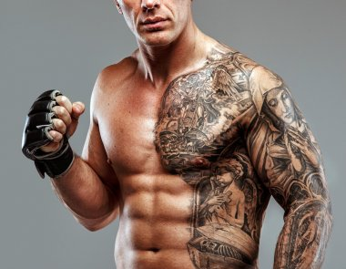 Strong muscular fighter with tattoo poses stock vector