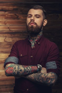 tattoed male looking seriously