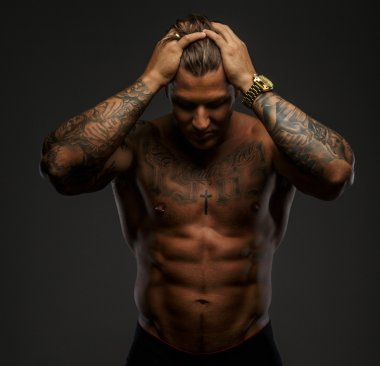 Muscular man with tattooes