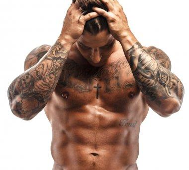 Tattooed muscular guy