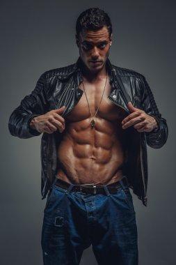 Casual muscular man in studio