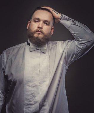 Serious man in white shirt