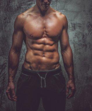 Muscular man posing in studio
