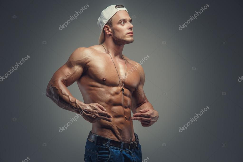 e44dbb52 Shirtless muscular guy in blue jeans — Stock Photo © fxquadro #75726311