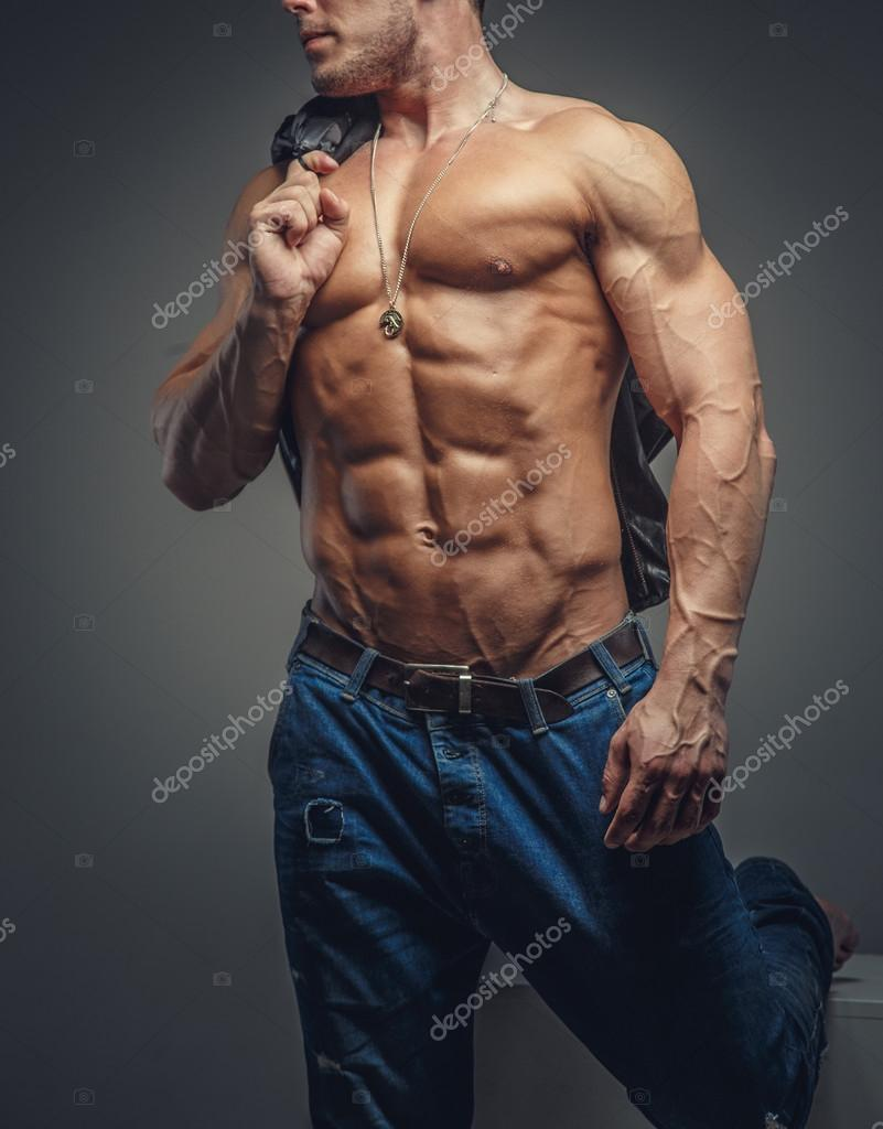 9658fe3a Shirtless muscular guy in blue jeans. — Stock Photo © fxquadro #75726351