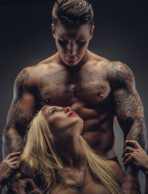Tattooed male and female.