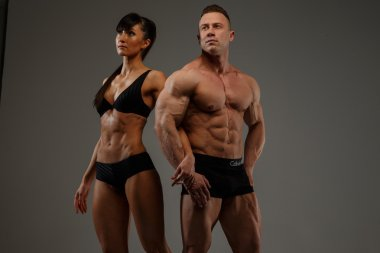 Couple of fitness woman and man bodybuilder