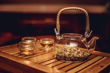 Glass chinese teapot with herbs
