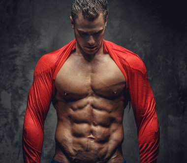 Muscular man over grey background.