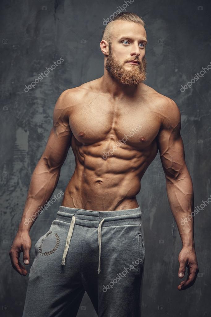Shirtless bodybuilder with beard. — Stock Photo © fxquadro