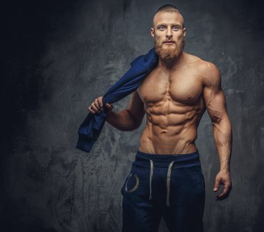 Portrait of muscular guy with beard.