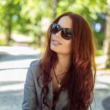 Portrait of smiling woman in sunglasses