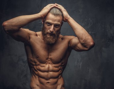 Shirtless muscular man with beard