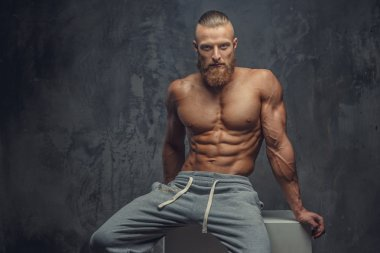 Shirtless muscular guy with beard