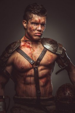 Muscular body of bloody gladiator