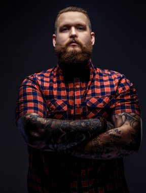 Man with beard and tattooes.