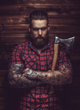 Brutal man with beard and tattooe.