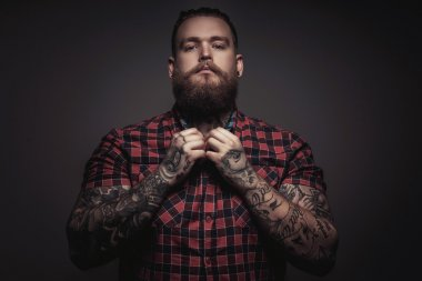 Brutal man with beard and tattoes