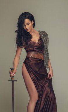 Picture of brunette woman with sword.