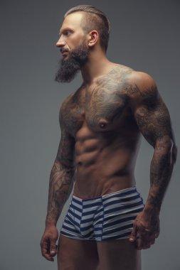 Fashinable mude tattooed man with beard.