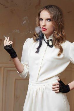 Blond woman smoking cigarette.