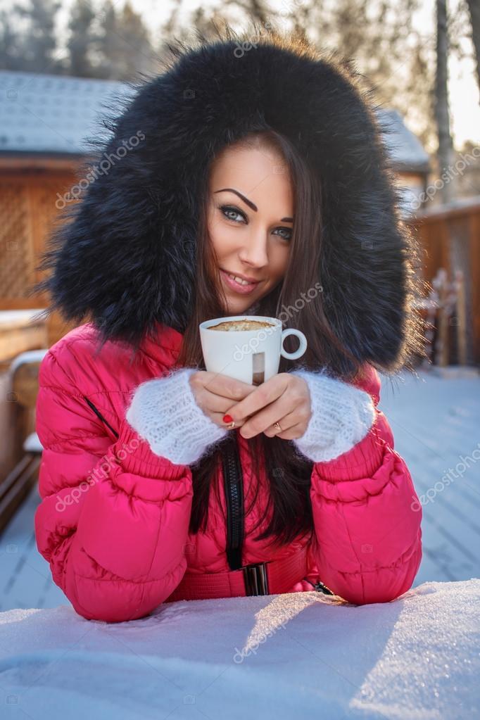Beautiful girl in winter pink coat.