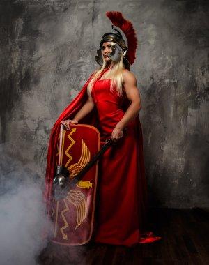 Woman in red fluttering dress.