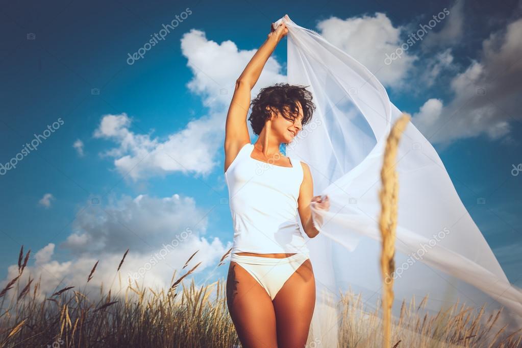 Middle age woman in white bikini.