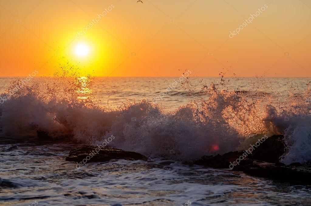 Sea waves on the sunset.