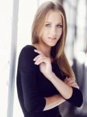 Photo Blond female in black dress.