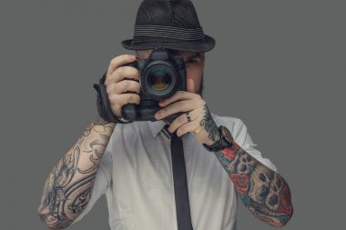 A man with tattooes on arms
