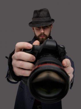 Bearded man with dslr camera.
