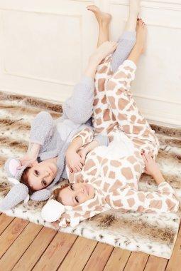Women in a pajamas having fun