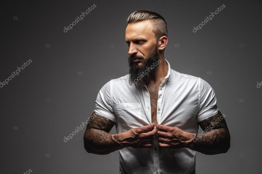 Bearded man with tattooed body.