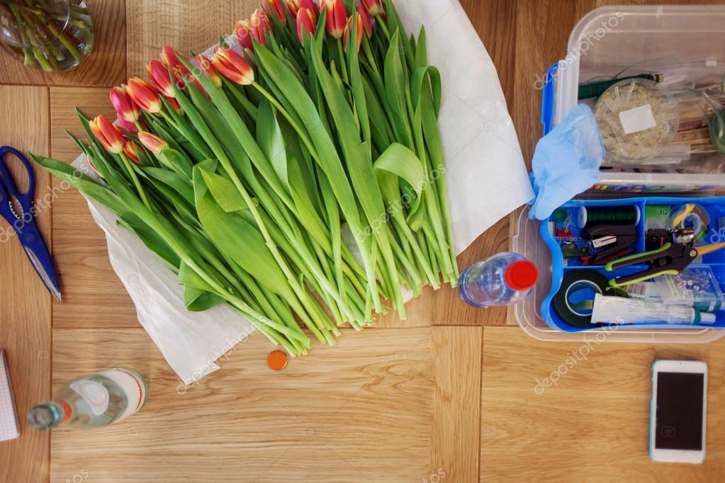 florist workplace, still life with bouquet of tulips, scissors and  tools