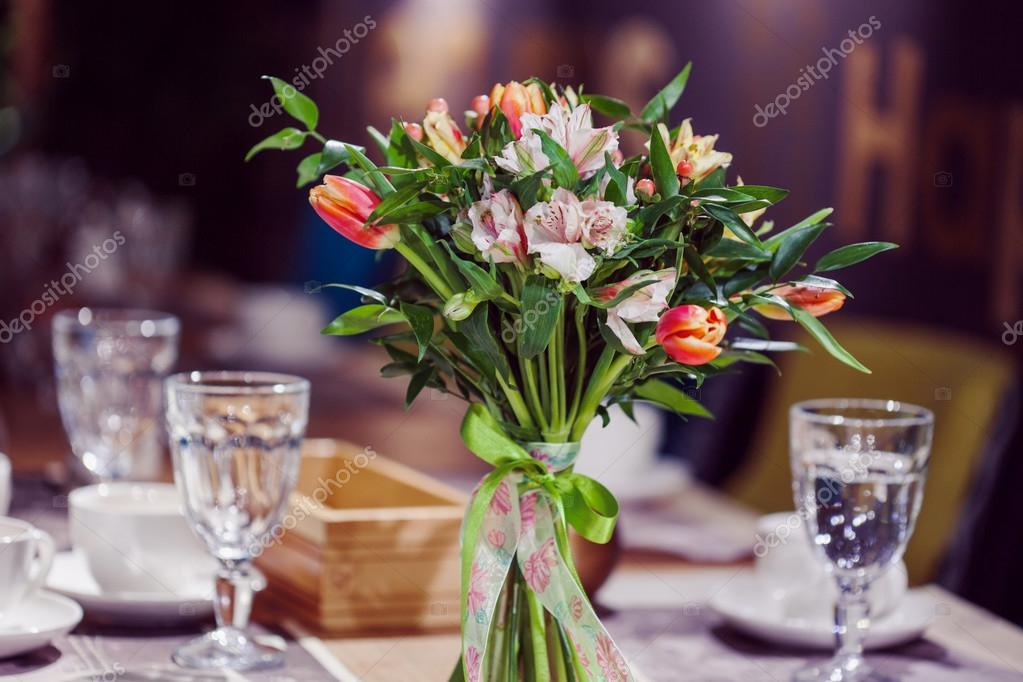 Flowers composition in restaurant, alstroemeria and tulips, combination of multiple colors