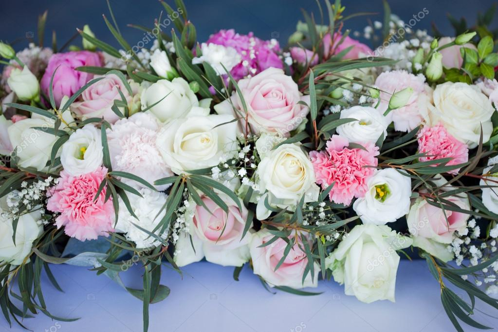 Flower arrangement on the table. Flowers and white tablecloth, wedding, roses, peonies